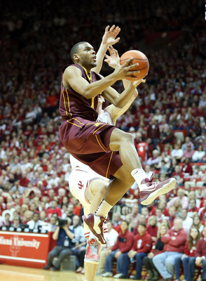 Hollins attempts a difficult running layup in a road loss to Indiana.