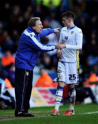 Leeds boss Neil Warnock issues instructions to Sam Byram.