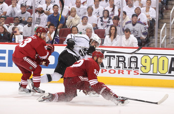 The Coyotes Nick Johnson tries to block a Los Angeles Kings shot on goal on Saturday night