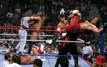 Shawn Michaels getting caught after a high risk move (Image Obtained From WWE.com)