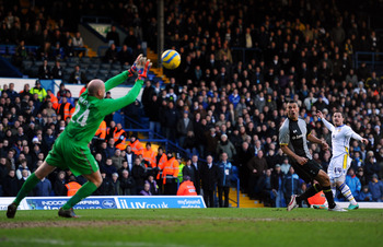 LEEDS, ENGLAND - JANUARY 27:  Ross McCormack of Leeds scores his team's second goal past Brad Friedel of Spurs during the FA Cup with Budweiser Fourth Round match between Leeds United and Tottenham Hotspur at Elland Road on January 27, 2013 in Leeds, Engl