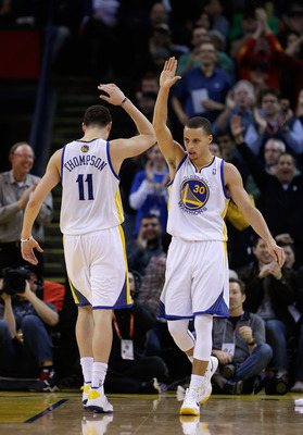 OAKLAND, CA - JANUARY 23:  Stephen Curry #30 of the Golden State Warriors is congratulated by Klay Thompson #11 after Curry made a basket and was fouled during their game against the Oklahoma City Thunder at Oracle Arena on January 23, 2013 in Oakland, Ca