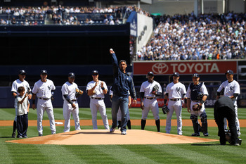 Jorge Posada is applauded by the crowd before throwing out the first pitch of an April 13, 2012 game against the Los Angeles Angels of Anaheim
