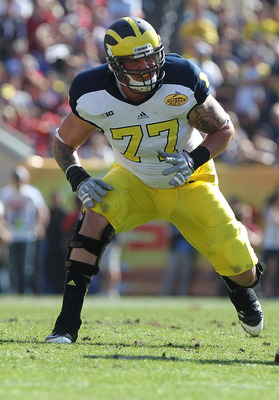 Taylor Lewan should help pave plenty of holes for Green to run through in 2013.