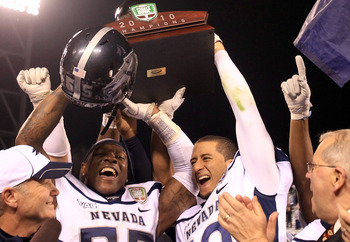 Colin Kapernick, middle right, hoists the Kraft Fight Hunger Bowl championship trophy.