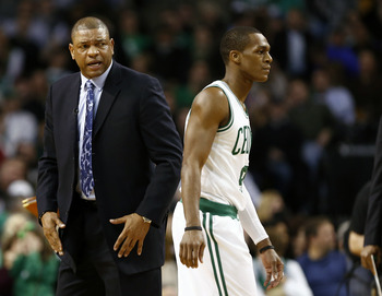 Jan 18, 2013; Boston, MA, USA; Boston Celtics head coach Doc Rivers (left) speaks with point guard Rajon Rondo (right) during the first half of a game against the Chicago Bulls at TD Garden.  Mandatory Credit: Mark L. Baer-USA TODAY Sports