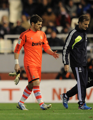 Real Madrid goalkeeper Iker Casillas leaves the field against Valencia after breaking a bone in his hand.