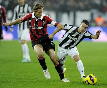 AC Milan captain Massimo Ambrosini is facing a race against time to be fit for the Champions League tie against Barcelona.