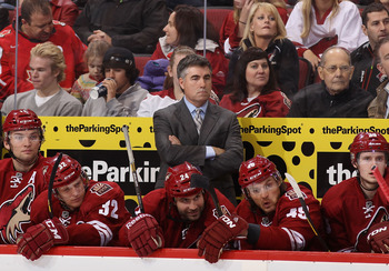 GLENDALE, AZ - JANUARY 26:  Head coach Dave Tippett of the Phoenix Coyotes reacts on the bench with teammates Martin Hanzal #11, Nick Johnson #32, Kyle Chipchura #24, Alex Bolduc #49 and Oliver Ekman-Larsson #23 during the NHL game at Jobing.com Arena on
