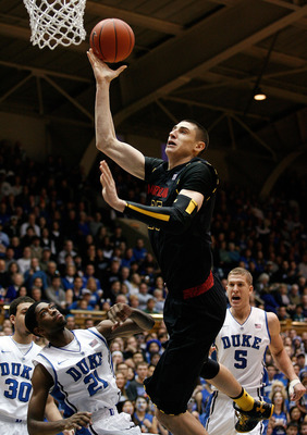 Jan 26, 2013; Durham, NC, USA; Maryland Terrapins center Alex Len (25) shoots over Duke Blue Devils forward Amile Jefferson (21) during the first half at Cameron Indoor Stadium.  Mandatory Credit: Mark Dolejs-USA TODAY Sports