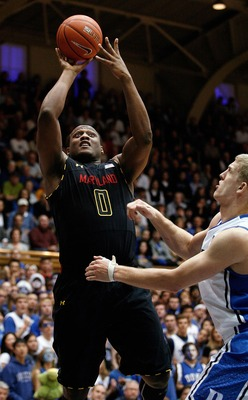 Jan 26, 2013; Durham, NC, USA; Maryland Terrapins forward Charles Mitchell (0) shoots over Duke Blue Devils forward Mason Plumlee (5) during the first half at Cameron Indoor Stadium.  Mandatory Credit: Mark Dolejs-USA TODAY Sports