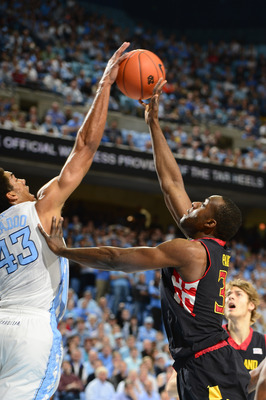 Jan 19, 2013; Chapel Hill, NC, USA; Maryland Terrapins forward James Padgett (35) has his shot blocked by North Carolina Tar Heels forward James Michael McAdoo (43) in the first half. The Tar Heels defeated the Terrapins 62-52 at the Dean E. Smith Center.