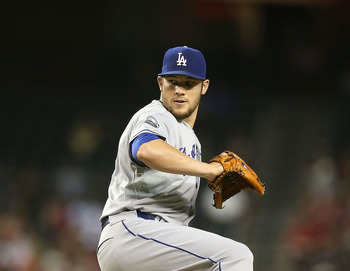 PHOENIX, AZ - JULY 05:  Relief pitcher Scott Elbert #57 of the Los Angeles Dodgers pitches against the Arizona Diamondbacks during the MLB game at Chase Field on July 5, 2012 in Phoenix, Arizona. The Dodgers defeated the Diamondbacks 4-1.  (Photo by Chris