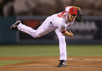 ANAHEIM, CA - SEPTEMBER 25:  Zack Greinke #23 of the Los Angeles Angels of Anaheim pitches against the Seattle Mariners at Angel Stadium of Anaheim on September 25, 2012 in Anaheim, California.  (Photo by Jeff Gross/Getty Images)