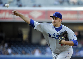 SAN DIEGO, CA - SEPTEMBER 26:  Aaron Harang #44 of the Los Angeles Dodgers pitches during the first inning of a baseball game against the San Diego Padres at Petco Park on September 26, 2012 in San Diego, California.  (Photo by Denis Poroy/Getty Images)