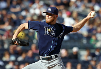 NEW YORK, NY - SEPTEMBER 16:  J.P. Howell #39 of the Tampa Bay Rays pitches against the New York Yankees at Yankee Stadium on September 16, 2012 in the Bronx borough of New York City.  (Photo by Alex Trautwig/Getty Images)