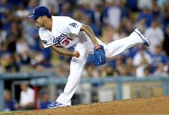 LOS ANGELES, CA - SEPTEMBER 29:  Closer Brandon League #31 of the Los Angeles Dodgers pitches in the ninth inning on his way to picking up the save against the Colorado Rockies on September 29, 2012 at Dodger Stadium in Los Angeles, California.  The Dodge
