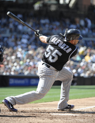 SAN DIEGO, CA - SEPTEMBER 4:   Eliezer Alfonzo #55 of the Colorado Rockies hits a single during the seventh inning of a baseball game against the San Diego Padres at Petco Park on September 4, 2011 in San Diego, California. (Photo by Denis Poroy/Getty Ima