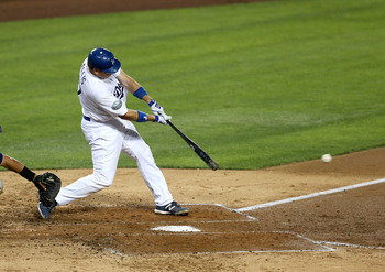 LOS ANGELES, CA - SEPTEMBER 29:  A.J. Ellis #17 of the Los Angeles Dodgers hits an RBI single in the fourth inning against the Colorado Rockies on September 29, 2012 at Dodger Stadium in Los Angeles, California.  (Photo by Stephen Dunn/Getty Images)