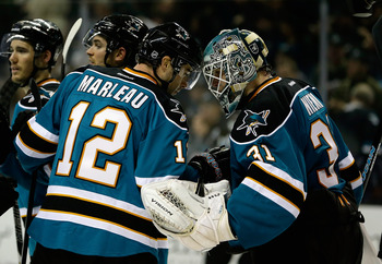 Center Patrick Marleau,left, and goaltender Antti Niemi.