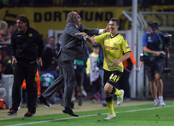 DORTMUND, GERMANY - SEPTEMBER 13:  Ivan Perisic of Borussia Dortmund celebrates scoring a goal during the UEFA Champions League Group F first leg match between Borussia Dortmund and Arsenal FC at Signal Iduna Park on September 13, 2011 in Dortmund, German