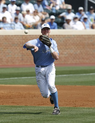 Jun 11, 2011; Chapel Hill, NC, USA; North Carolina third baseman Colin Moran (18) throws to first during the first inning of the Chapel Hill super regional of the 2011 NCAA baseball tournament at Boshamer Stadium.  Mandatory Credit: Bob Donnan-USA TODAY S