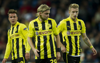 MADRID, SPAIN - NOVEMBER 06: Marcel Schmelzer (C) of Borussia Dortmund stands with his teammates during the UEFA Champions League group D match between Real Madrid and Borussia Dortmund at Estadio Santiago Bernabeu on November 6, 2012 in Madrid, Spain.  (