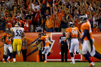 DENVER, CO - SEPTEMBER 9:  Cornerback Tracy Porter #22 of the Denver Broncos returns an interception for a touchdown during the fourth quarter against the Pittsburgh Steelers at Sports Authority Field Field at Mile High on September 9, 2012 in Denver, Col