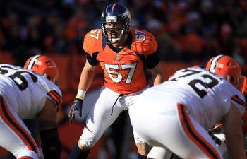 DENVER, CO - DECEMBER 23:  Middle linebacker Keith Brooking #57 of the Denver Broncos plays defense against the Cleveland Browns at Sports Authority Field at Mile High on December 23, 2012 in Denver, Colorado. The Broncos defeated the Browns 34-12.  (Phot