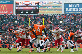 DENVER, CO - DECEMBER 30: Outside linebacker Andy Studebaker #96 and free safety Tysyn Hartman #31 of the Kansas City Chiefs pressure punter Britton Colquitt #4 of the Denver Broncos during a punt from deep inside Broncos territory at Sports Authority Fie