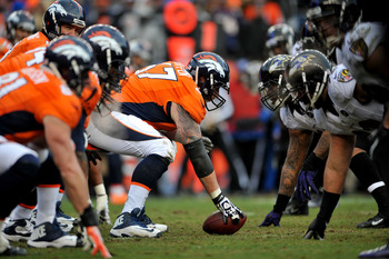 DENVER, CO - JANUARY 12:  Dan Koppen #67 of the Denver Broncos gets set to snap the ball at the line of scrimmage against the Baltimore Ravens during the AFC Divisional Playoff Game at Sports Authority Field at Mile High on January 12, 2013 in Denver, Col