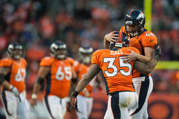 DENVER, CO - DECEMBER 23:  Long snapper Aaron Brewer #46 and running back Lance Ball #35 of the Denver Broncos celebrates recovering a fumble by the Cleveland Browns on a punt at Sports Authority Field Field at Mile High on December 23, 2012 in Denver, Co