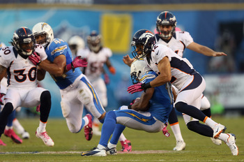 SAN DIEGO, CA - OCTOBER 15:   Matt Willis #12 of the Denver Broncos tackles Eddie Royal #11 of the San Diego Chargers in the first quarter during the NFL game at Qualcomm Stadium on October 15, 2012 in San Diego, California.  (Photo by Jeff Gross/Getty Im
