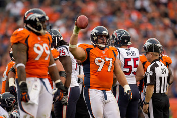 DENVER, CO - SEPTEMBER 23:  Defensive tackle Justin Bannan #97 of the Denver Broncos shows the ball to the crowd after recovering a fumble during the fourth quarter against the Houston Texans at Sports Authority Field Field at Mile High on September 23, 2