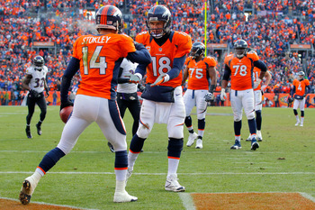 DENVER, CO - JANUARY 12:  Peyton Manning #18 oand Brandon Stokley #14 of the Denver Broncos celebrate after Stokley caught a 15-yard toucdown reception in from Manning in the first quarter against the Baltimore Ravens during the AFC Divisional Playoff Gam