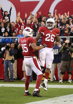 Beanie Wells (right) and Michael Floyd celebrate a rare offensive touchdown.