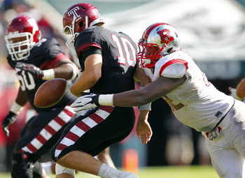Greene (right) forcing a fumble during a 35-10 domination of Temple.  Greene also returned a fumble for a touchdown this game.