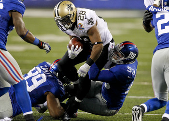 Blackburn (93) helping to tackle Saints running back Mark Ingram during their Week 13 victory.