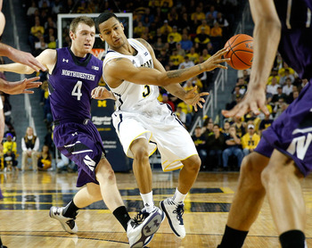 ANN ARBOR, MI - JANUARY 30:  Trey Burke #3 of the Michigan Wolverines passes to a teammate in front of Alex Marcotullio #4 of the Northwestern Wildcats during the first half at Crisler Center on January 30, 2013 in Ann Arbor, Michigan. (Photo by Gregory S