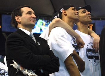 2 Apr 2001:  Head coach Mike Krzyzewski (from left) of Duke watches the net cutting along with his players Shane Battier and Carlos Boozer after defeating Arizona 82-72 in the NCAA National Championship Game of the Men's Final Four tournament at the Metro
