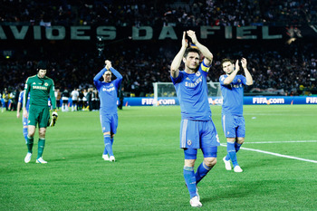 Chelsea players applaud the fans who made the long trip to Japan with them.