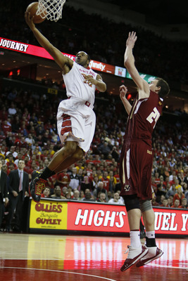 Jan 22, 2013; College Park, MD, USA; Maryland Terrapins guard Dez Wells (32) drives for a basket in the closing minutes against Boston College Eagles center Dennis Clifford (24) at Comcast Center. Mandatory Credit: Mitch Stringer-USA TODAY Sports