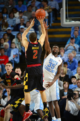 Jan 19, 2013; Chapel Hill, NC, USA; Maryland Terrapins guard Logan Aronhalt (2) shoots as Maryland Terrapins forward James Padgett (35) defends in the second half. The Tar Heels defeated the Terrapins 62-52 at the Dean E. Smith Center. Mandatory Credit: B