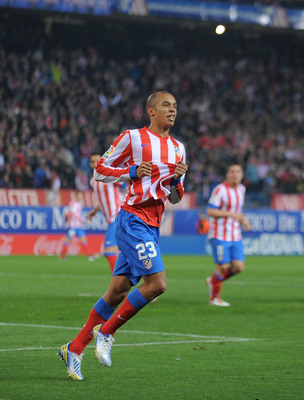 MADRID, SPAIN - NOVEMBER 25:  Joao Miranda of Club Atletico de Madrid celebrates after scoring his team's 4th goal during the La Liga match between Club Atletico de Madrid and Sevilla FC at Vicente Calderon Stadium on November 25, 2012 in Madrid, Spain.