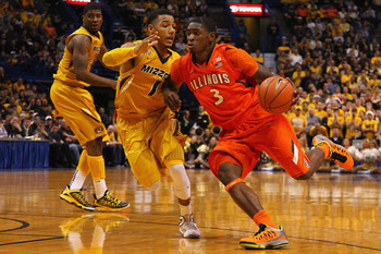 ST. LOUIS, MO - DECEMBER 22: Brandon Paul #3 of the Illinois Fighting Illini drives to the basket against Phil Pressey #1 of the Missouri Tigers during the Bud Light Braggin' Rights game at the Scottrade Center on December 22, 2012 in St. Louis, Missouri.