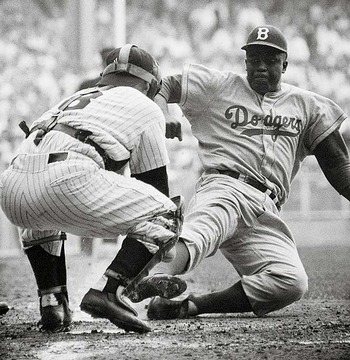 Jackie Robinson scores a run in his first MLB game (image courtesy of www.toptenz.net).
