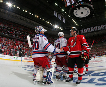 NEWARK, NJ - MAY 25:  Zach Parise #9 of the New Jersey Devils shakes hands with Henrik Lundqvist #30 of the New York Rangers after the Devils defeating the Rangers by a score of 3-2 to win Game Six of the Eastern Conference Final during the 2012 NHL Stanl