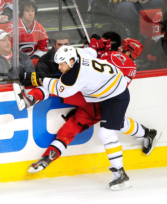 The new Sabre drills Carolina's Chad LaRose,