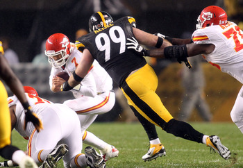 November 12, 2012; Pittsburgh, PA, USA; Kansas City Chiefs quarterback Matt Cassel (7) is sacked by Pittsburgh Steelers defensive end Brett Keisel (99) during the first quarter at Heinz Field. Mandatory Credit: Charles LeClaire-USA TODAY Sports