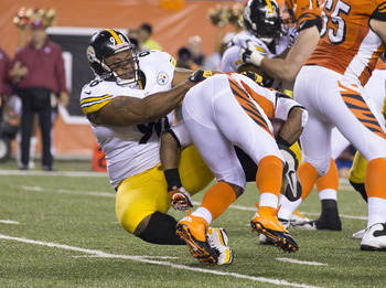 October 21, 2012; Cincinnati, OH, USA; Pittsburgh Steelers nose tackle Casey Hampton (98) tackles Cincinnati Bengals running back BenJarvus Green-Ellis (42) in the backfield at Paul Brown Stadium. Pittsburgh won the game 24-17. Mandatory Credit: Greg Bart